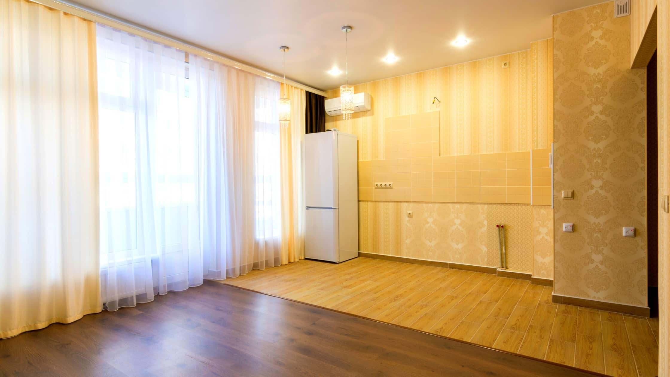 Living room is perfectly decorated by lights and brownish wallpaper